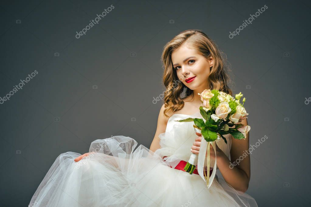 portrait of beautiful bride with wedding bouquet in hand
