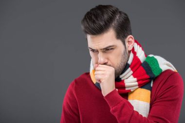 Sick man coughing in warm scarf, isolated on grey stock vector