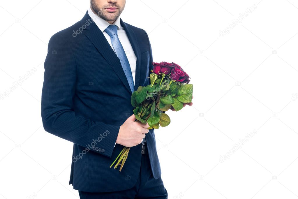 cropped view of elegant man holding bouquet of red roses, isolated on white