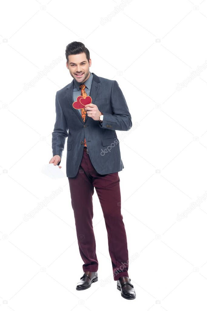 smiling man with valentines greeting card, isolated on white