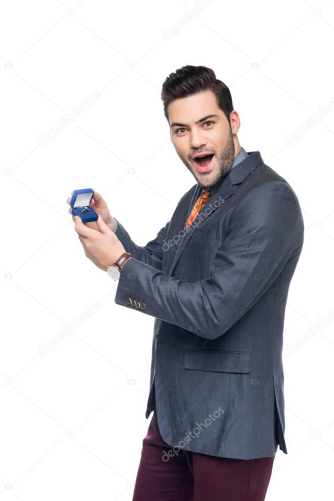 excited man holding box with proposal ring, isolated on white