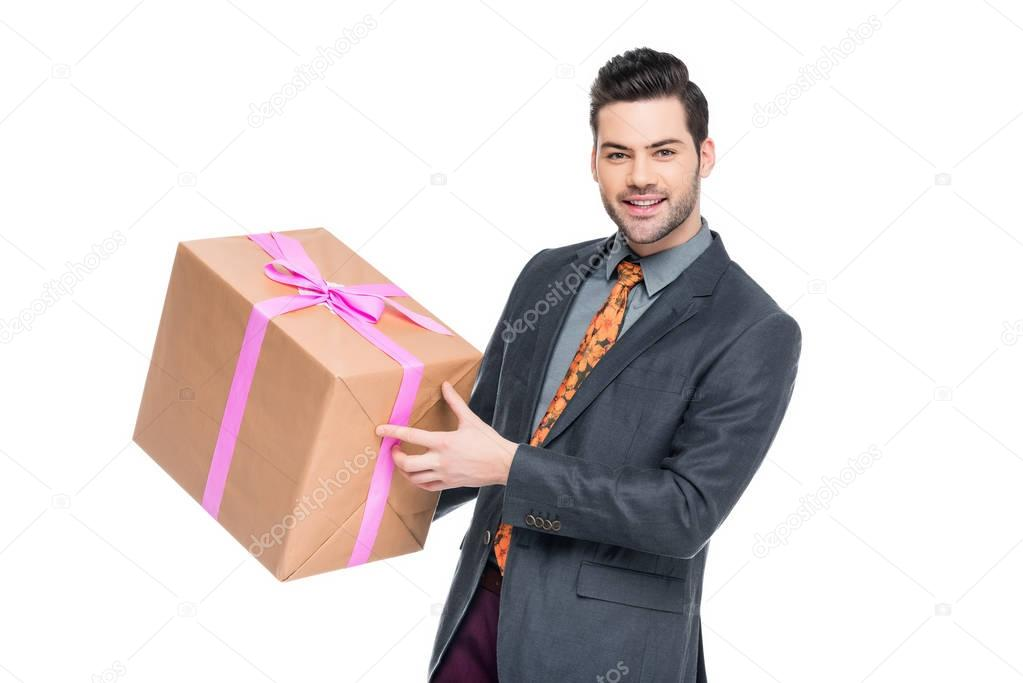 handsome bearded man holding gift box, isolated on white