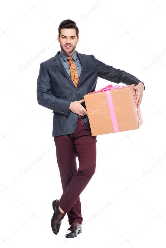 handsome beardman holding gift box, isolated on white
