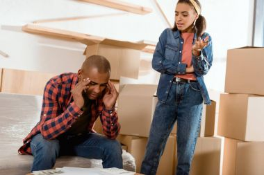 african american quarreling couple moving to new apartment
