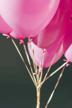 Close up view of pink balloons isolated on grey stock vector