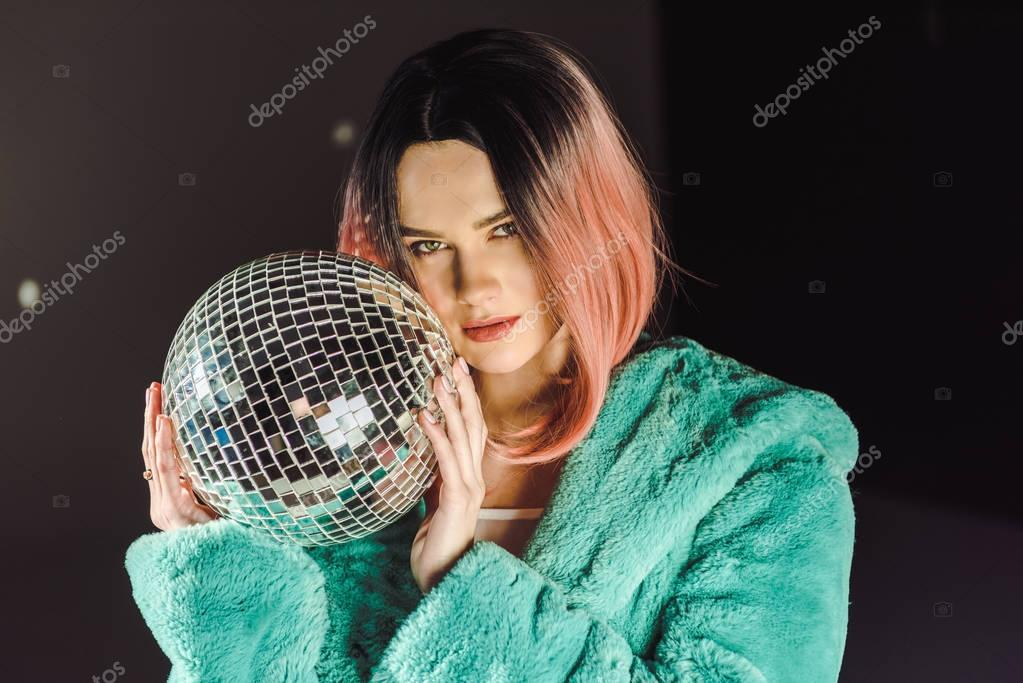 beautiful girl with pink hair holding disco ball
