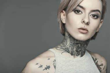 Attractive tattooed girl, isolated on grey stock vector