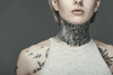 Cropped view of attractive tattooed girl, isolated on grey stock vector