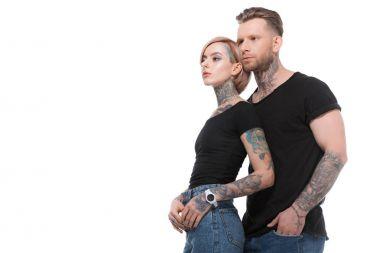 fashionable tattooed couple posing together, isolated on white