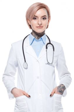 beautiful doctor in white coat with stethoscope, isolated on white