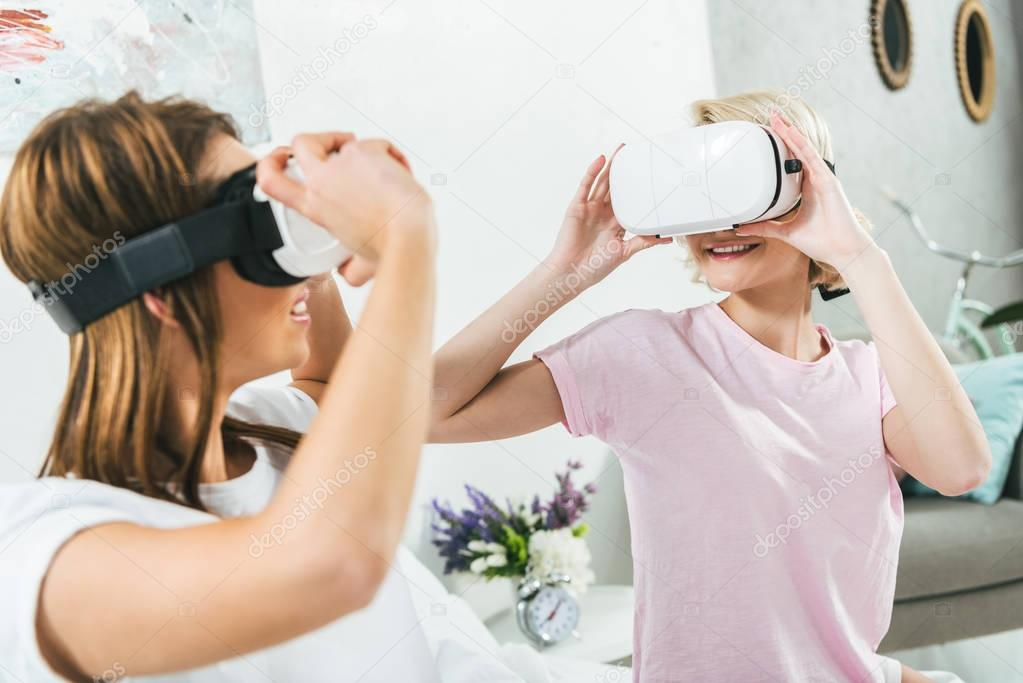 beautiful girls having fun and using virtual reality headsets at home