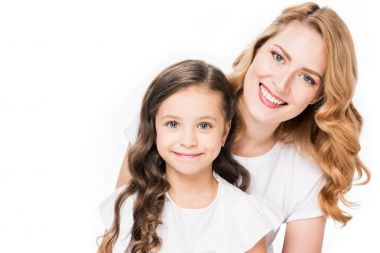 Portrait of smiling mother and daughter looking at camera isolated on white stock vector
