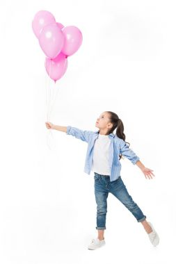 adorable little kid looking at pink balloons in hand isolated on white