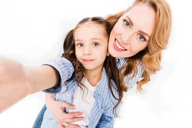 camera point of view of mother and daughter taking selfie together isolated on white