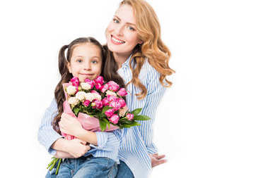 cheerful mother and little daughter with bouquet of flowers isolated on white, mothers day concept
