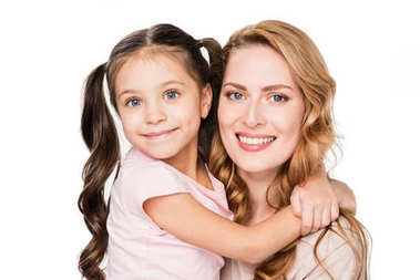 portrait of smiling daughter hugging mother isolated on white