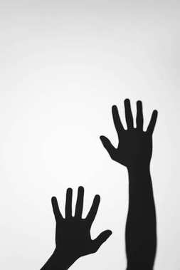 Scary mysterious shadows of human hands on grey stock vector