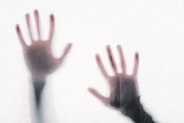 Blurry silhouette of human hands touching frosted glass stock vector