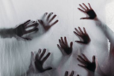 Blurry scary silhouettes of human hands touching frosted glass stock vector