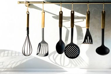 close-up view of various utensils hanging in kitchen