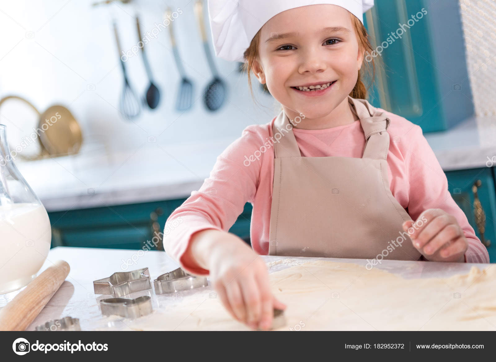Adorable Child Chef Hat Apron Smiling Camera While Preparing Cookies