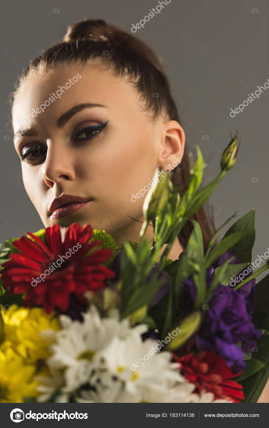 Portrait beautiful girl bouquet flowers looking camera isolated grey portrait of beautiful girl with bouquet of flowers looking at camera isolated on grey photo by allaserebrina izmirmasajfo