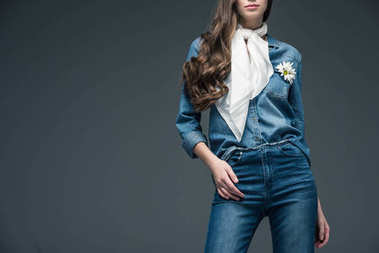 cropped view of girl with long hair posing in scarf and denim shirt with flowers, isolated on grey