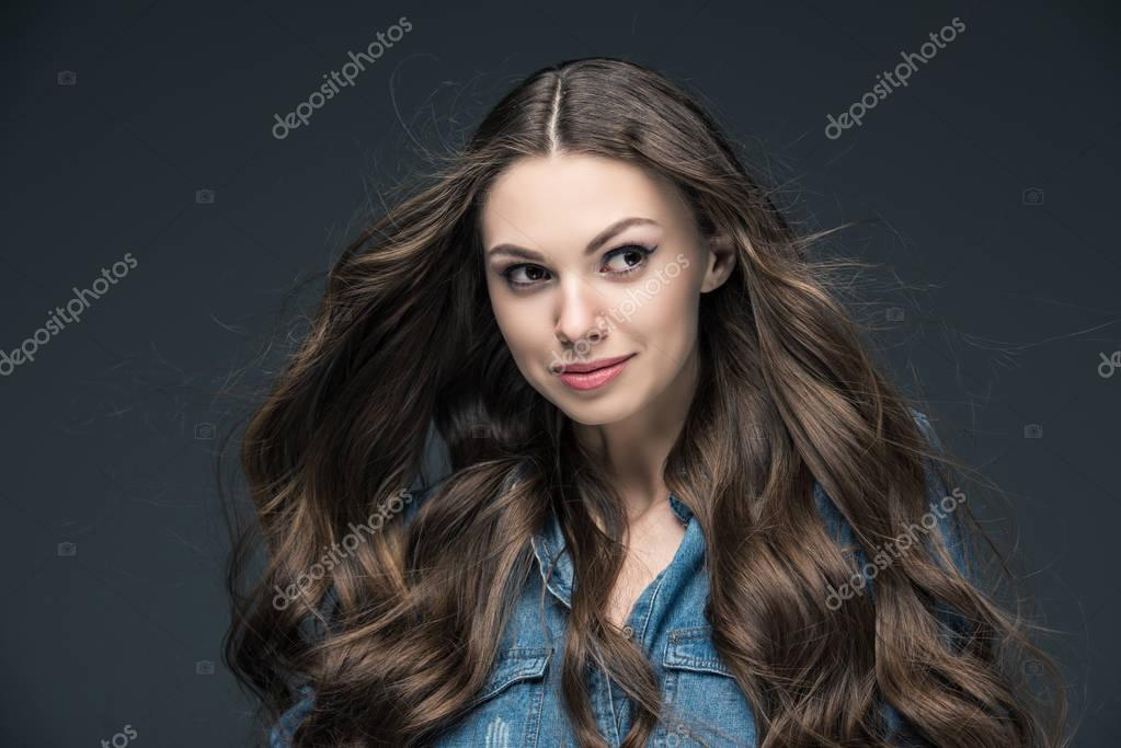 portrait of pretty girl with long hair, isolated on grey