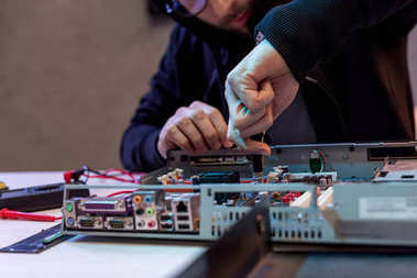 Cropped image of man fixing computer stock vector