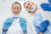 Fotografie Dentists checking patient teeth in modern clinic