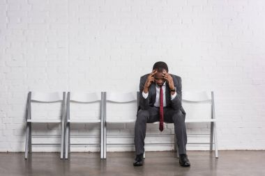 worried african american businessman waiting for job interview