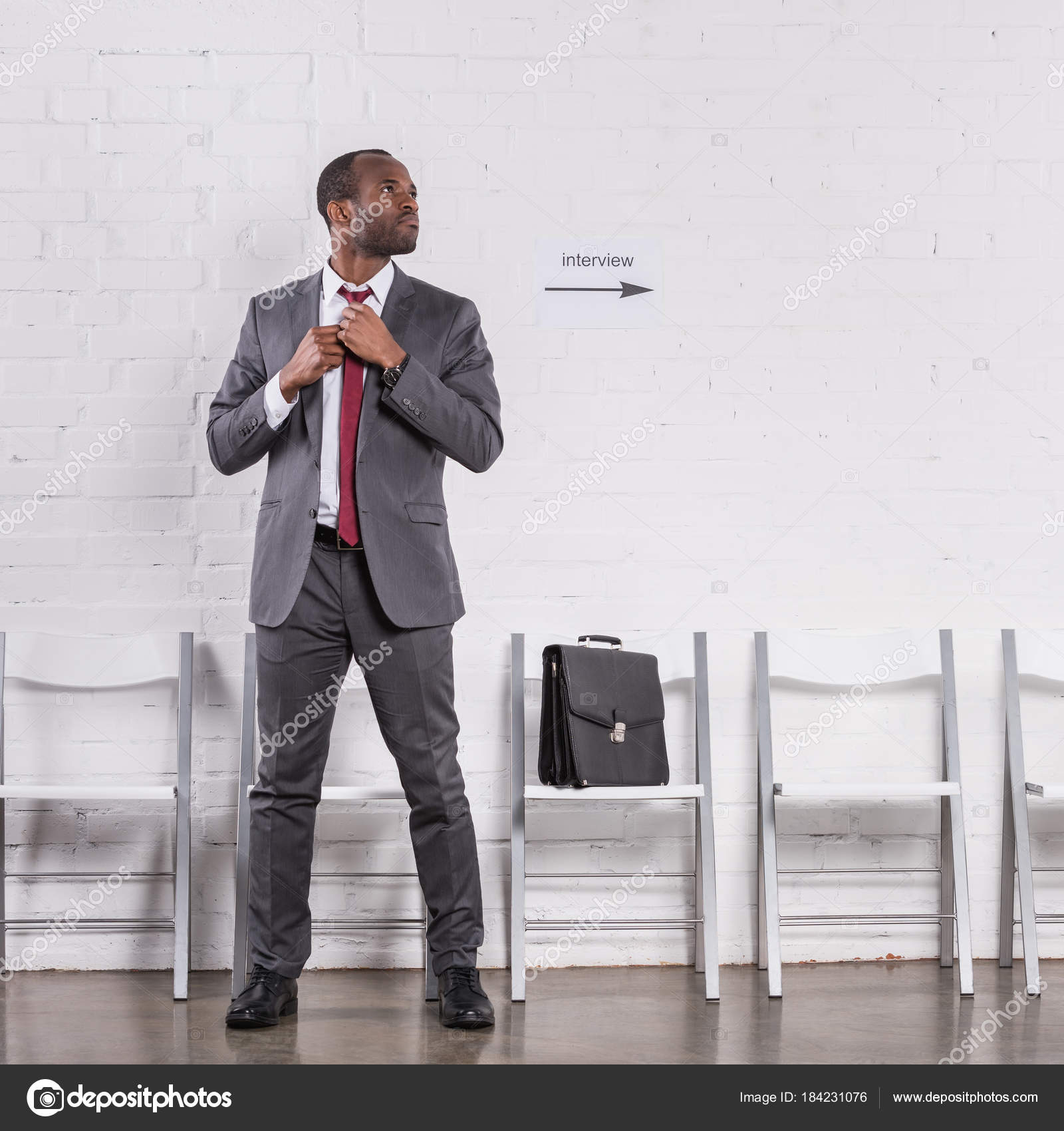 African american businessman tying bow tie waiting job interview african american businessman tying bow tie waiting for job interview photo by allaserebrina ccuart Gallery