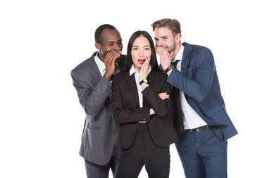 portrait of multiethnic businessmen telling secret to asian businesswoman isolated on white