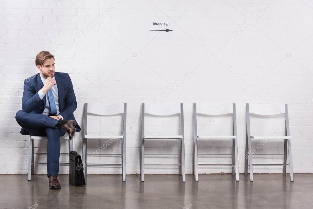 pensive caucasian businessman waiting for job interview