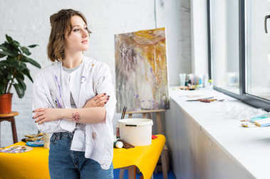 Young artistic girl looking in window in light studio stock vector