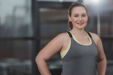 Portrait of obese girl smiling in gym