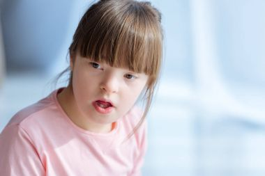 Portrait of thoughtful child with down syndrome