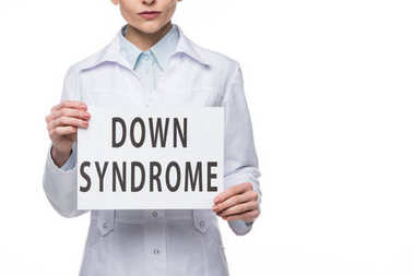 Female doctor holding paper with Down Syndrome inscription isolated on white