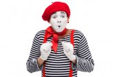 Photo scared mime looking at camera isolated on white