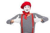 Photo happy mime showing thumbs up isolated on white