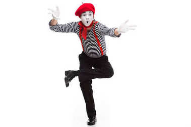 funny mime performing and gesturing isolated on white