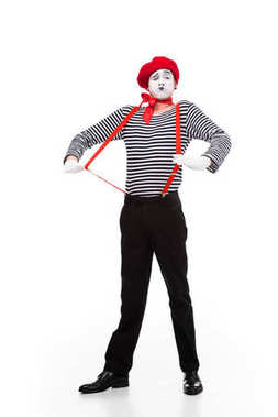 grimacing mime with red suspenders isolated on white
