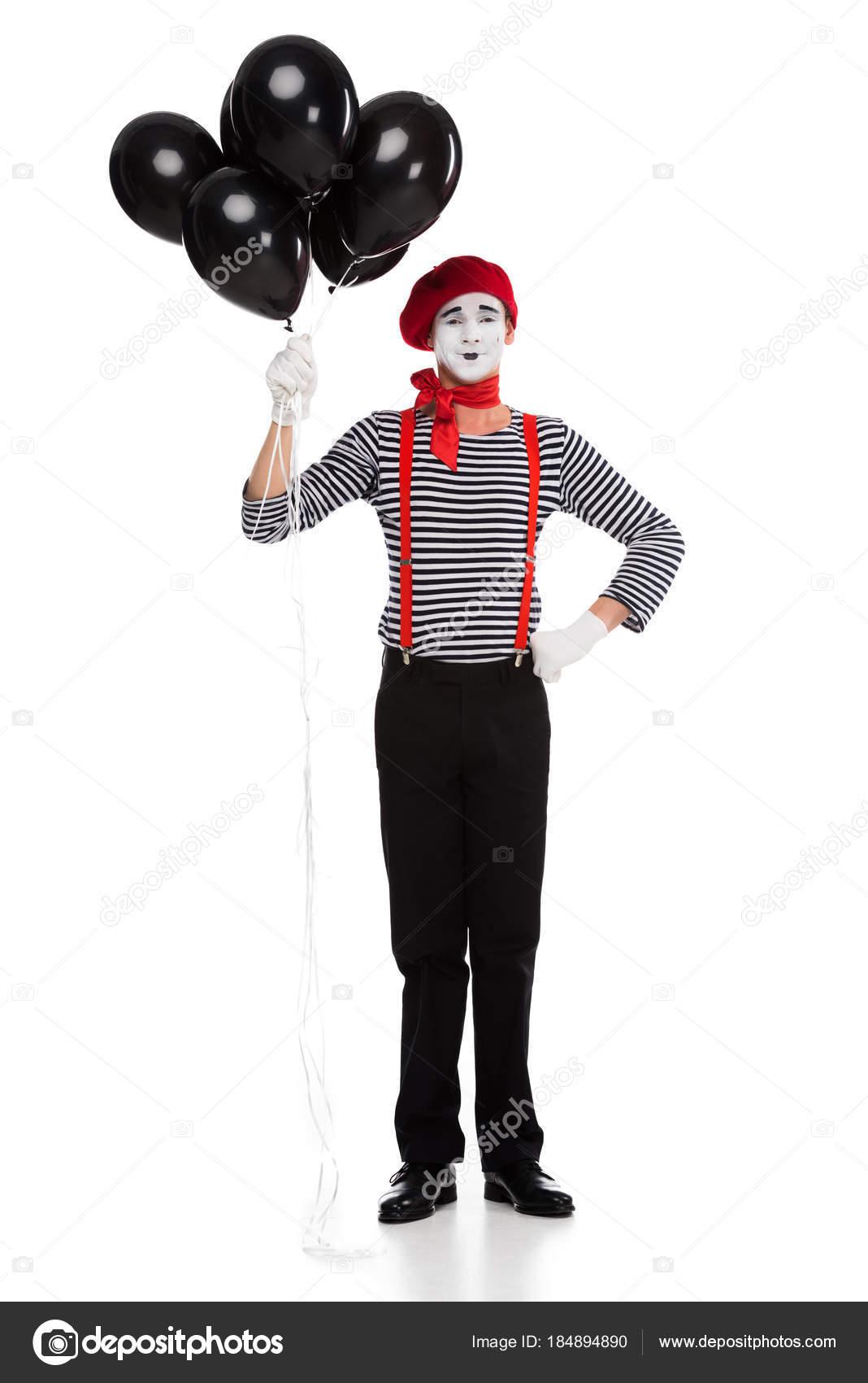 陽気な mime 白で隔離ヘリウムと黒い風船の束を保持 ストック写真