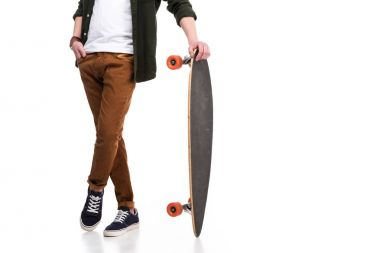 Cropped image of skateboarder standing with longboard on white stock vector