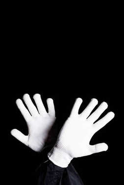 cropped image of mime showing block sign isolated on black