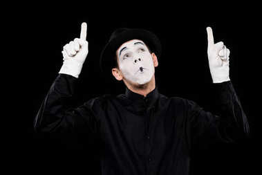 grimacing mime pointing on something isolated on black