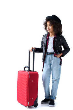 Beautiful little child standing with luggage and looking away isolated on white stock vector