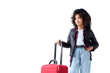 adorable little child in stylish clothing with suitcase isolated on white