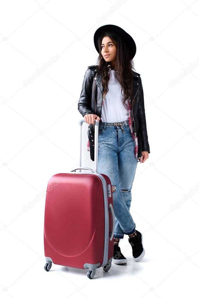 attractive young woman with luggage isolated on white
