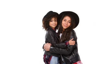 beautiful embracing mother and daughter in leather jackets and hats mother and daughter isolated on white